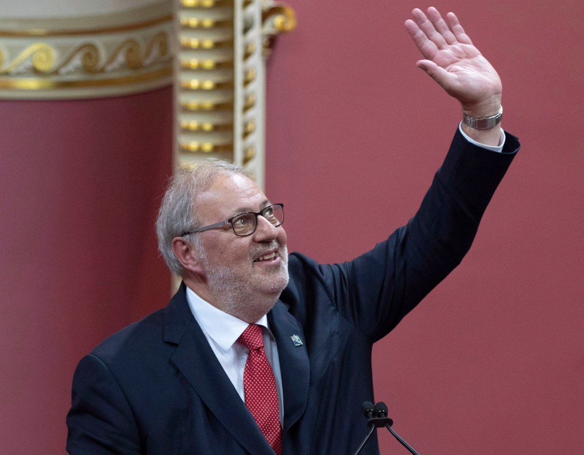 Quebec Liberal Opposition Leader Pierre Arcand waves to the applauding crowd as he is sworn in as member of the National Assembly Monday, Oct. 15, 2018, at the legislature in Quebec City.
