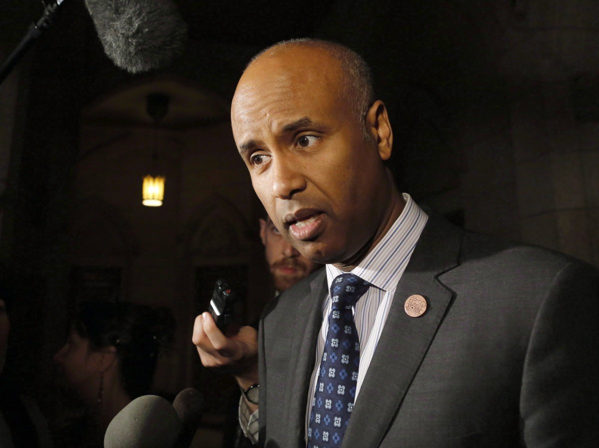 FILE - Minister of Immigration, Refugees and Citizenship Ahmed Hussen speaks to reporters outside the House of Commons on Parliament Hill on Thursday, May 31, 2018.