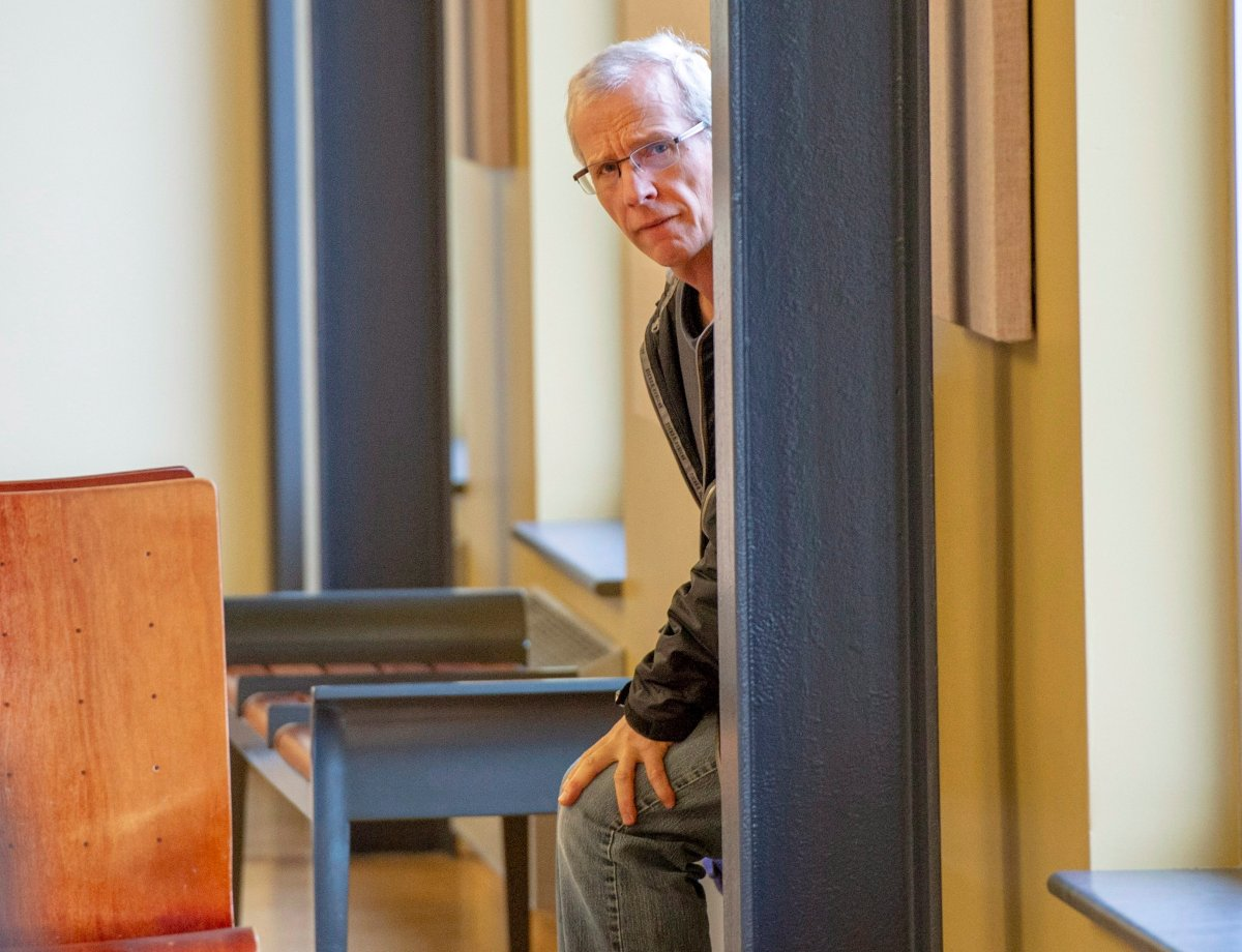 Normand Dubé waits to enter the courtroom for final sentencing arguments, Wednesday, October 31, 2018 in St. Jerome, Que. Dube was found guilty in September on three counts of mischief after he used a small plane to cripple power lines carrying electricity to southwestern Quebec.