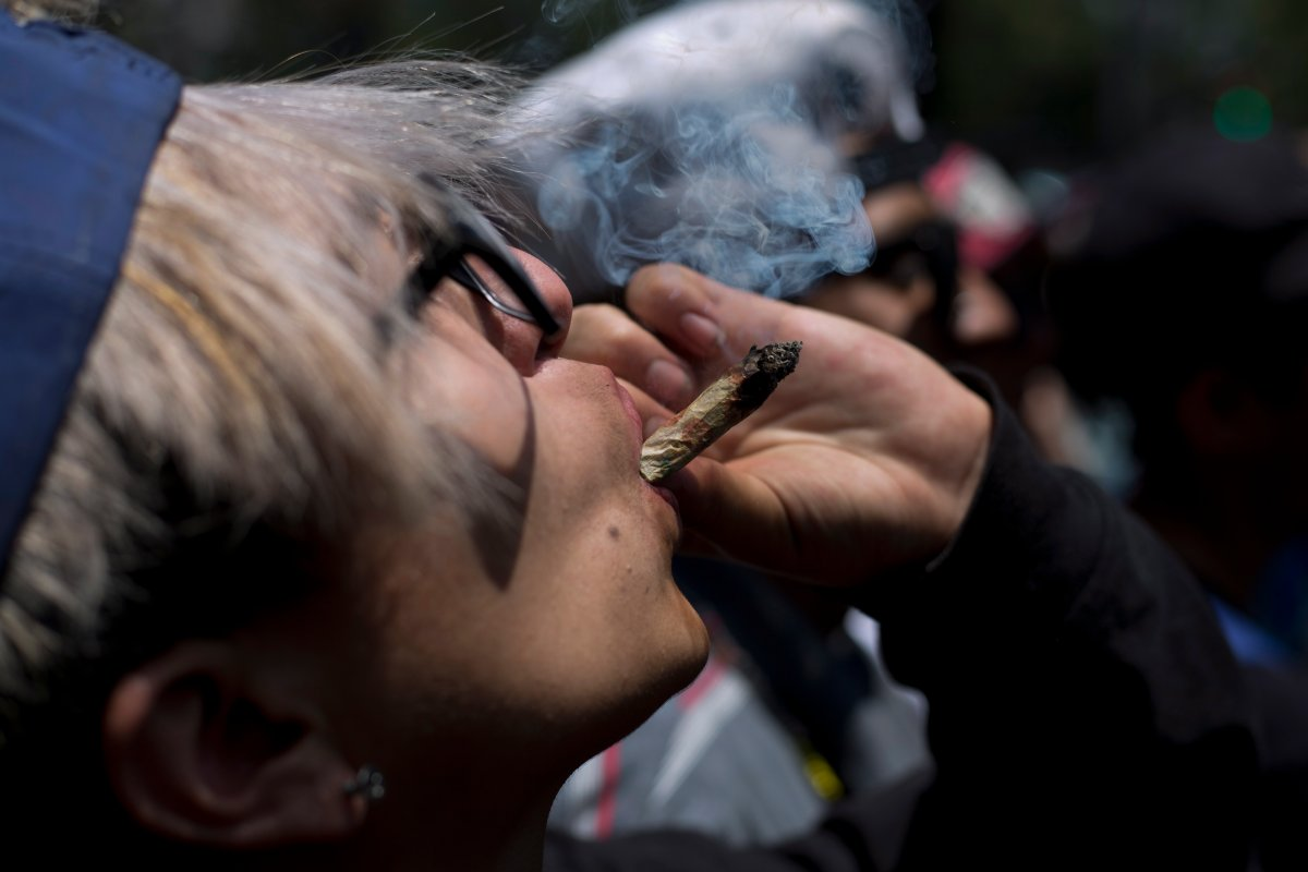 FILE - In this April 20, 2018 file photo,  a young man smokes marijuana to celebrate the International Day for Cannabis in Mexico City.