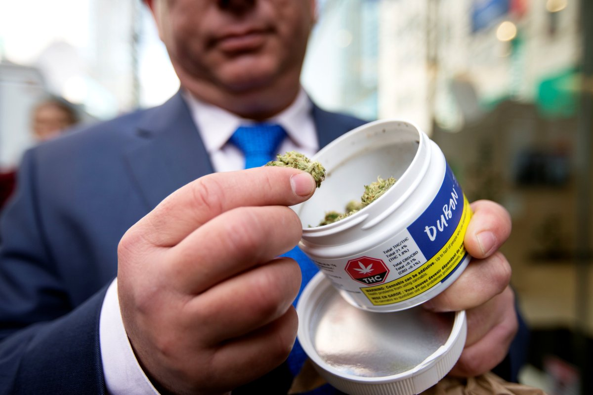 A man shows off his cannabis purchase outside the Quebec Cannabis Society (SQDC) store.