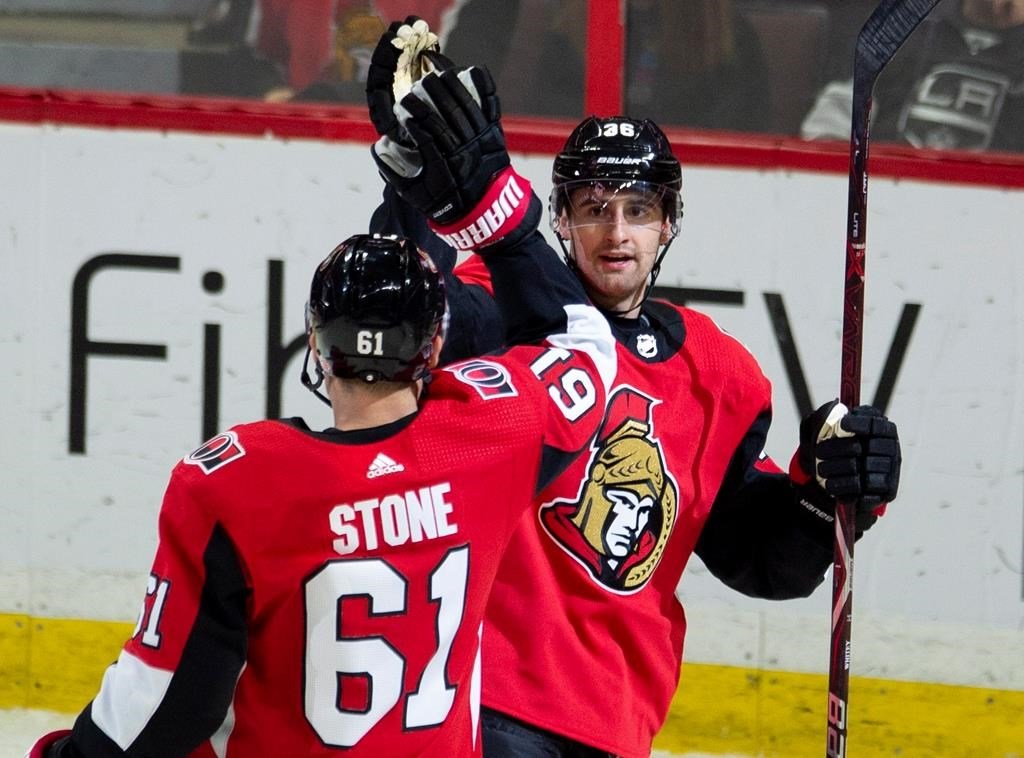 Ottawa Senators centre Colin White (36) celebrates his goal with teammate right wing Mark Stone (61) during second period NHL action against the Los Angeles Kings in Ottawa on Saturday, October 13, 2018.