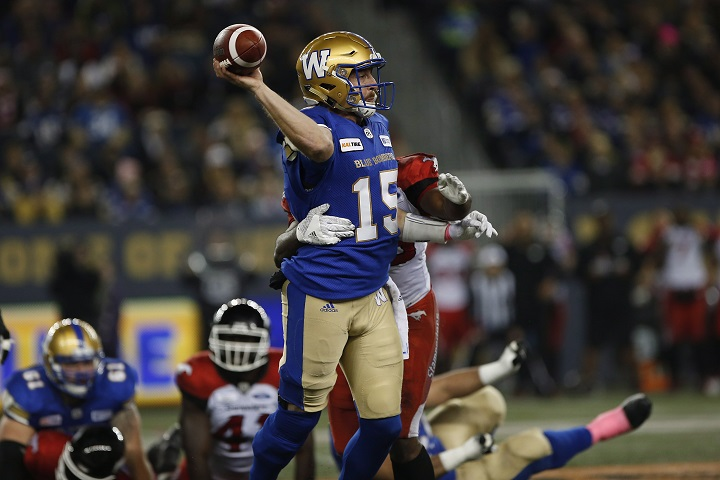 Winnipeg Blue Bombers quarterback Matt Nichols (15) gets the ball away during the first half of CFL action against the Calgary Stampeders, in Winnipeg, Friday, Oct. 26, 2018.