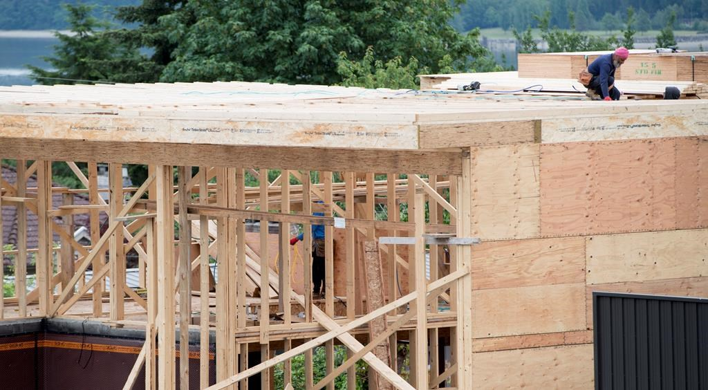 A new home is under construction in North Vancouver, B.C., Tuesday, June 12, 2018. The annual pace of Canadian housing starts in September slowed compared with August. THE CANADIAN PRESS Jonathan Hayward.
