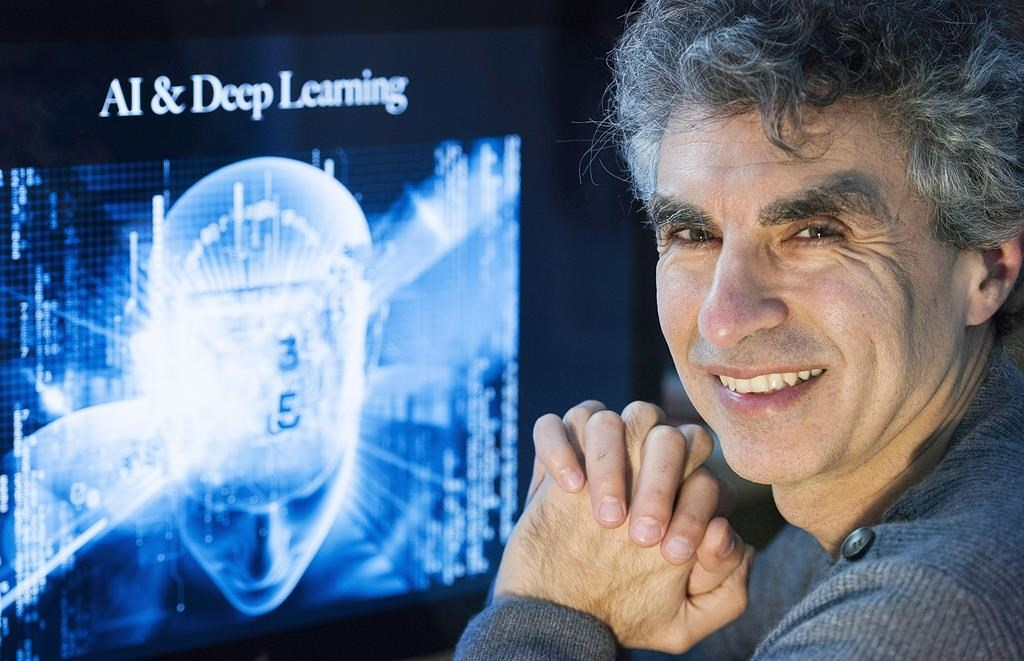 Computer Science professor Yoshua Bengio poses at his home in Montreal, Saturday, November 19, 2016. The Element AI co-founder will serve as a technical adviser for ServiceNow.