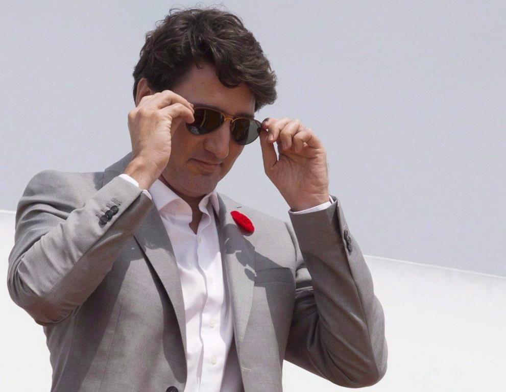 Canadian Prime Minister Justin Trudeau removes his sunglasses as he arrives in Ho Chi Minh City, Vietnam on Thursday November 9, 2017.