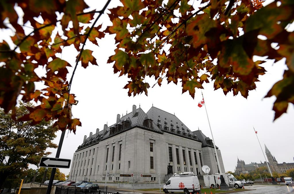 The Supreme Court of Canada is seen in Ottawa on Thursday, Oct. 11, 2018. The Supreme Court of Canada says it will hear a legal dispute over whether the Ontario government can force Weyerhaeuser Co. and Resolute Forest Products to clean up mercury contamination near the Grassy Narrows First Nation.