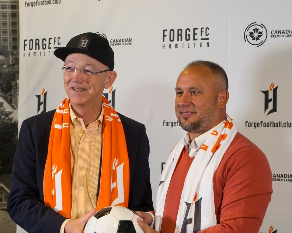 Forge FC team owner Bob Young, left, and head coach and technical director Bobby Smyrniotis pose during a press conference in Hamilton, Ont., on Monday, Oct. 1, 2018.
