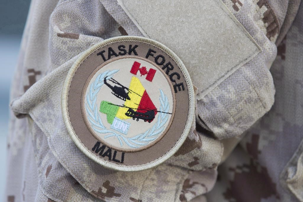 The UN Mali patch is shown on a Canadian forces member's uniform before boarding a plane at CFB Trenton in Trenton, Ont., on July 5, 2018.