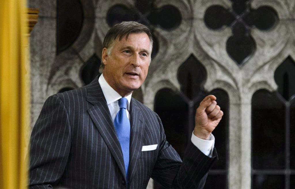 In this file photo, MP Maxime Bernier stands to speak in the House of commons. The Conservatives have named Richard Lehoux to face Bernier in the Beauce riding in 2019.