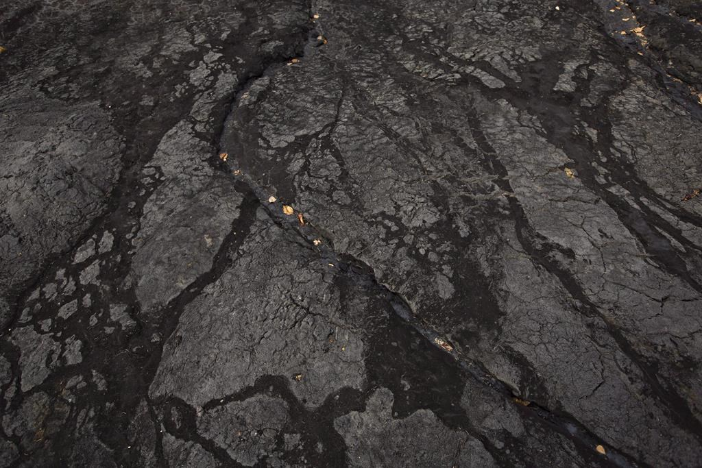 Bitumen in an open mine area is shown at the historic Bitumount oil sands mining, separating and refining facility in Fort McMurray Alta, on Tuesday October 5, 2016. A Calgary financial analyst says prices being paid for Western Canadian oilsands bitumen have fallen so far that producers are actually losing money on every barrel sold into the spot market. THE CANADIAN PRESS/Jason Franson.