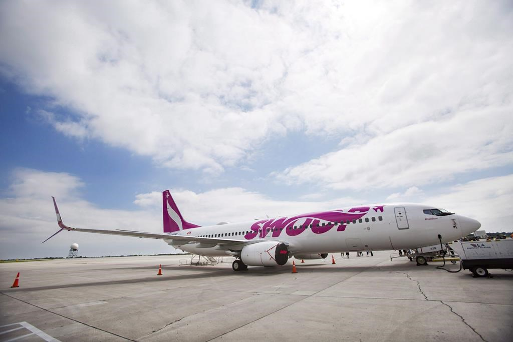 Swoop Airlines Boeing 737 on display during their media event, Tuesday, June 19, 2018 at John C. Munro International Airport in Hamilton, Ont.