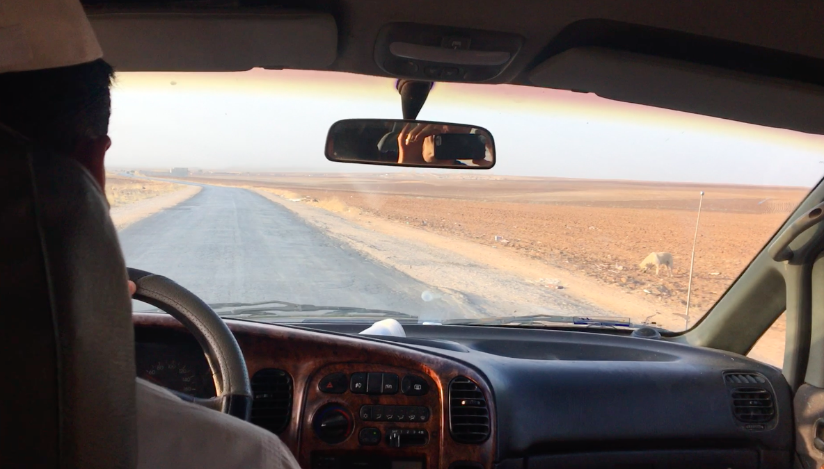 Driving across the empty landscape of northeastern Syria.