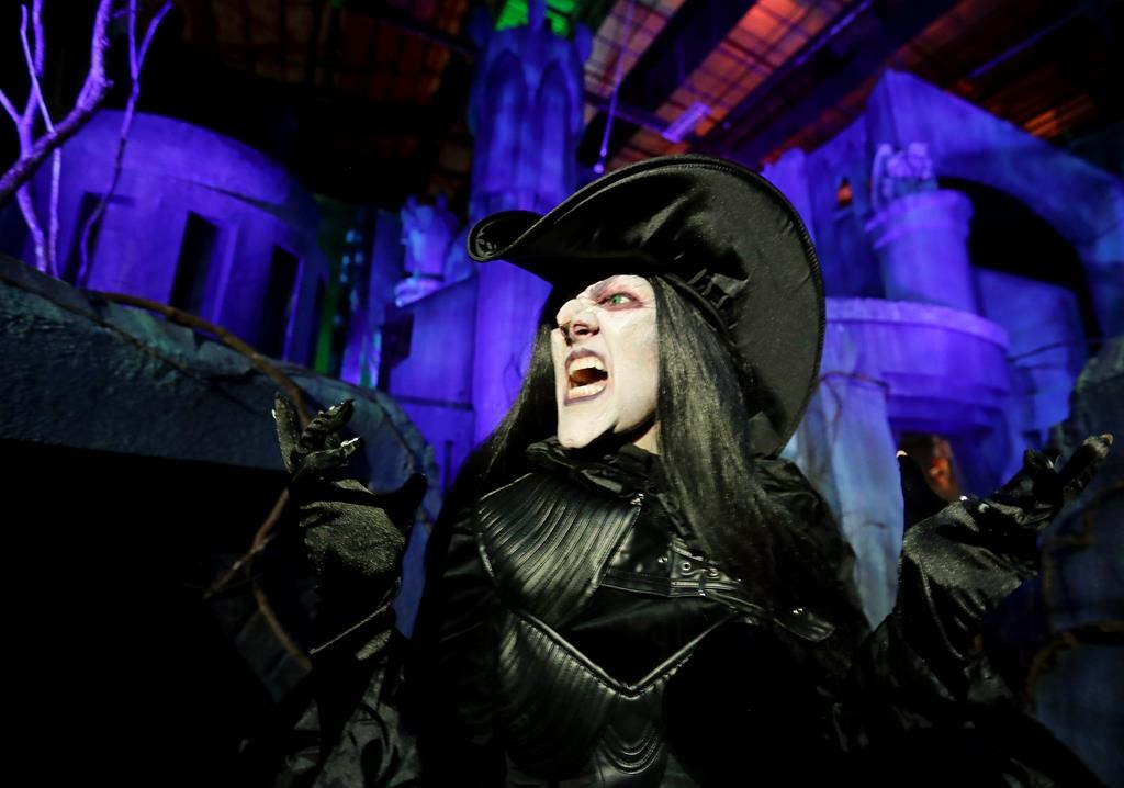 In this Wednesday, Sept. 12, 2018 photo, Laura Law performs as a witch at the Scary Tales haunted house at Halloween Horror nights at Universal Studios in Orlando, Fla.