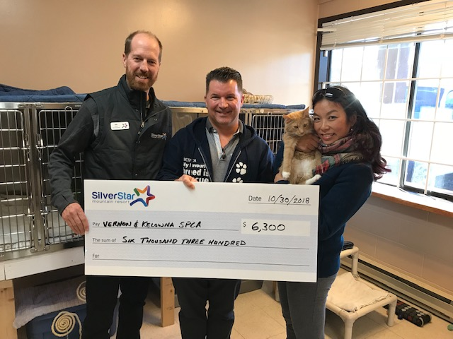 Silver Star Mountain Resort's Wesla Wong and Ian Jenkins hand over a cheque for $6,300 to the BC SPCA.
