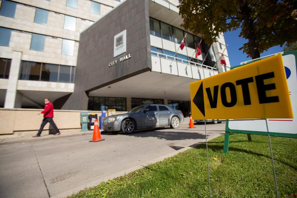 A sign points voters towards a polling station at City Hall in London, Ont., on Monday, October 22, 2018. London is the first municipality to adopt a ranked ballot system in Canada. THE CANADIAN PRESS/Geoff Robins.