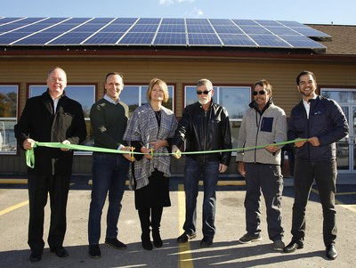 Officials launch a new solar installation at Hiawatha First Nation on Tuesday.