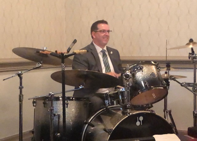 Cam Guthrie celebrates by playing the drums after being re-elected for a second term as mayor of Guelph.