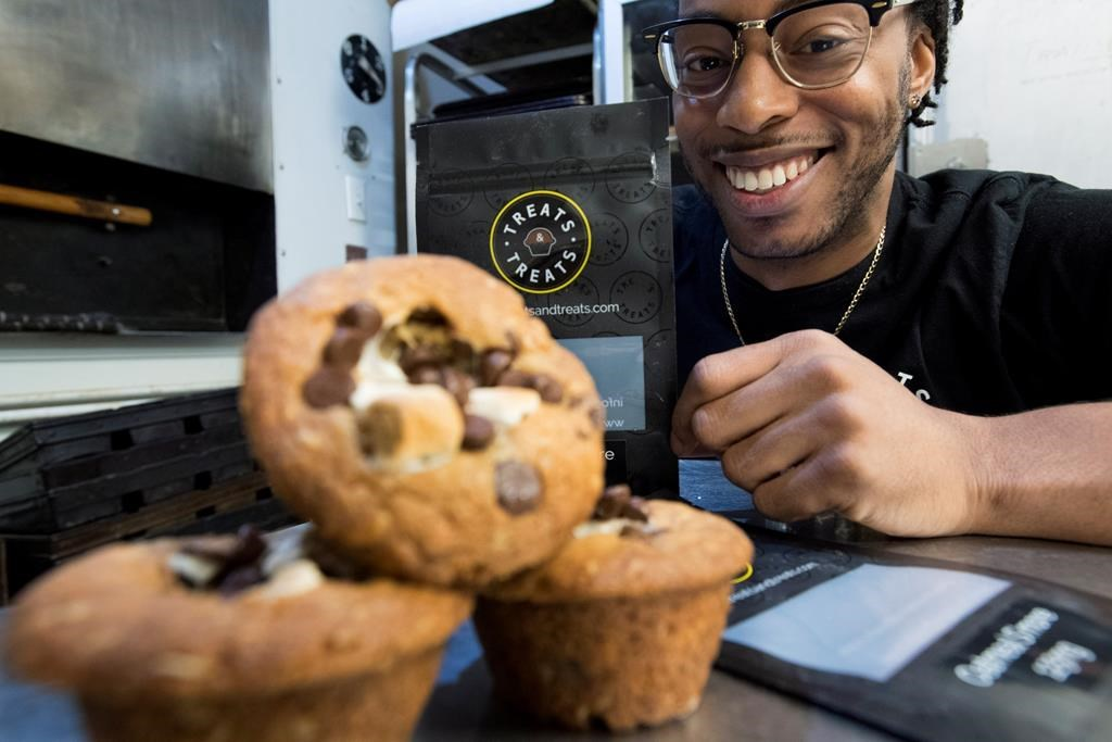 Yannick Craigwell shows off some of his edible marijuana baked treats in Vancouver, Wednesday, Oct. 3, 2018.