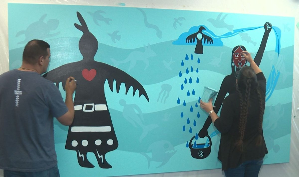 Artists Christi Belcourt and Isaac Murdoch working on their painting at MacEwan University's kihêw waciston Indigenous Centre in Edmonton, Alta. October 30, 2018.