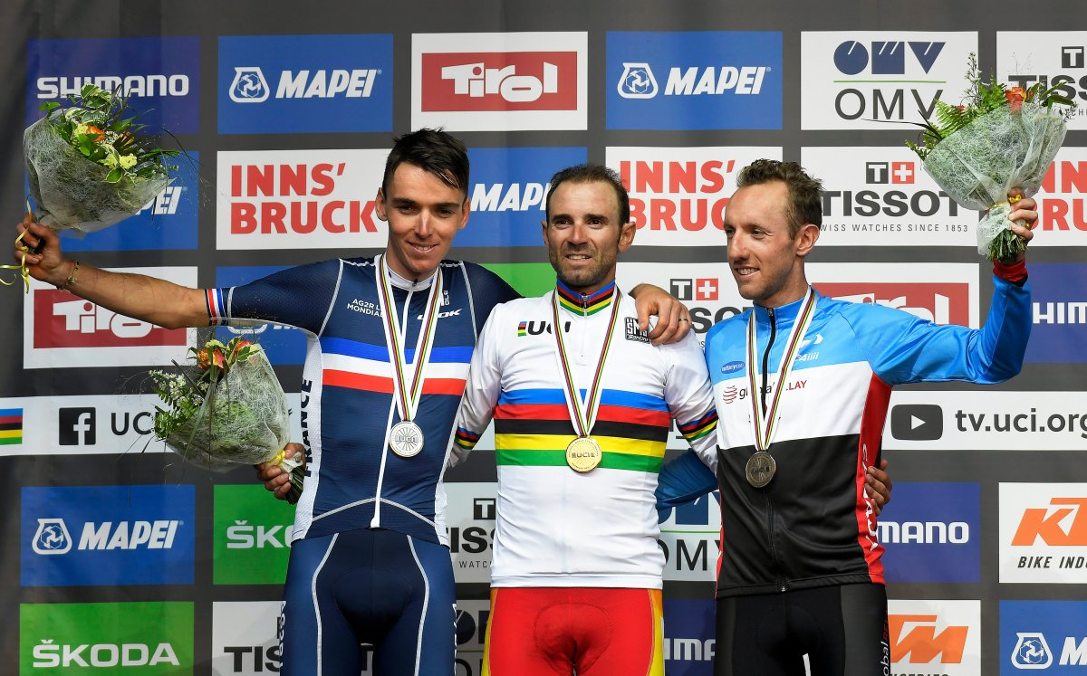 Alejandro Valverde (C) of Spain poses with his gold medal on the podium after winning the men's Elite Road Race of the UCI Road Cycling World Championships over 258km from Kufstein to Innsbruck, Austria, 30 September 2018. Valverde won ahead of second placed Romain Bardet (L) of France and third placed Michael Woods (R) of Canada.