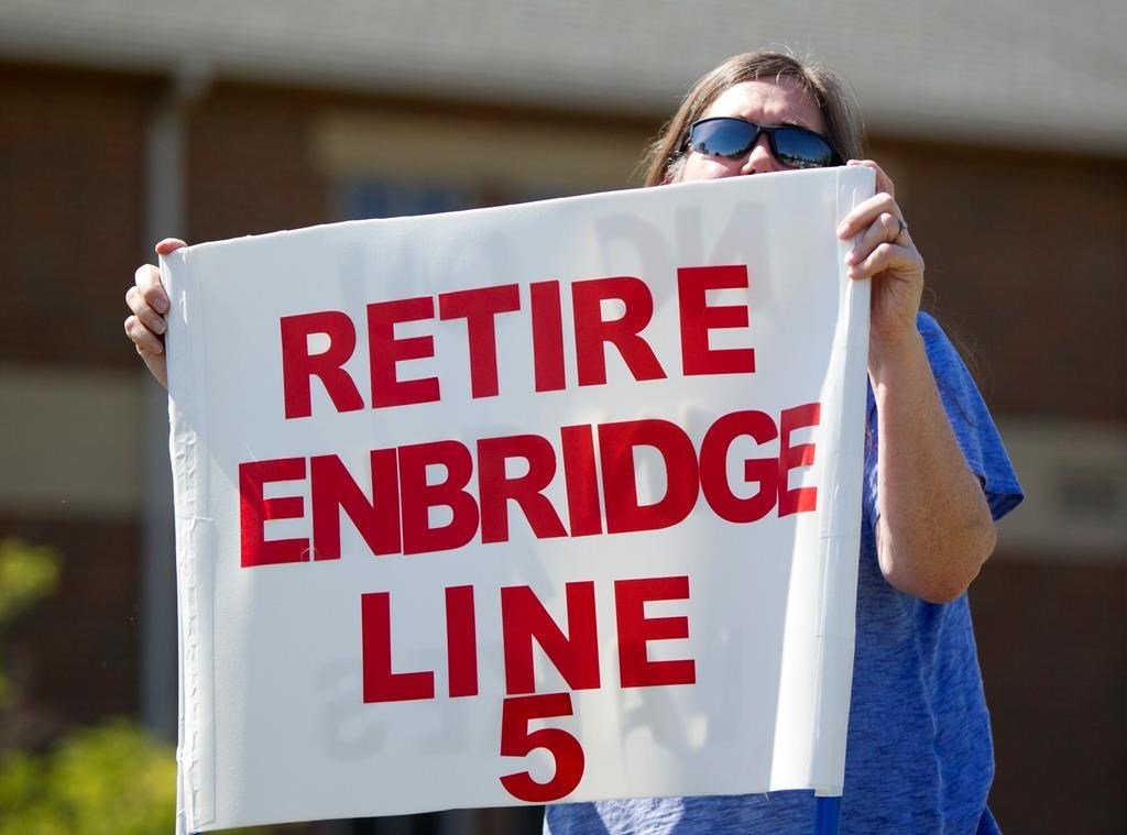 In this July 6, 2017, file photo, Lauren Sargent, takes part in a protest before the Enbridge Line 5 pipeline public information session in Holt, Mich.