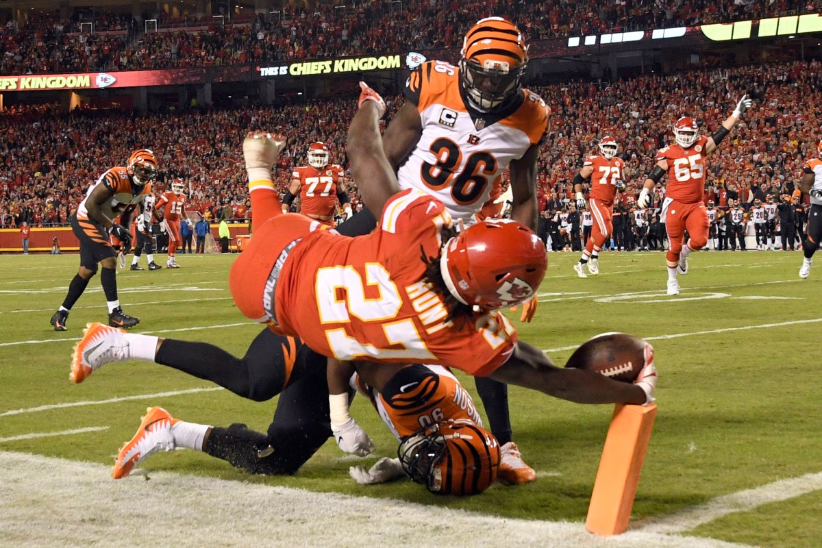 Cincinnati Bengals safety Shawn Williams (36) watches as Kansas City Chiefs running back Kareem Hunt (27) leaps over defensive end Michael Johnson (90) for a touchdown during the first half of an NFL football game in Kansas City, Mo., Sunday, Oct. 21, 2018.