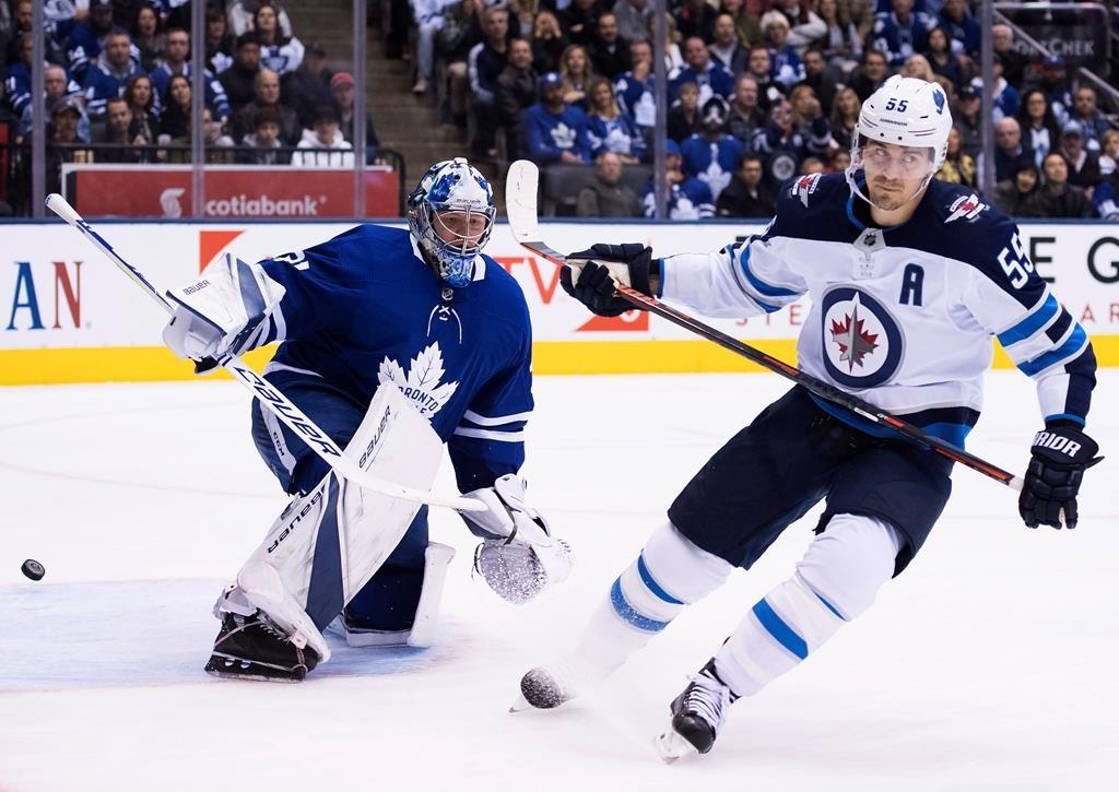 Winnipeg Jets centre Mark Scheifele (55) scores past Toronto Maple Leafs goaltender Frederik Andersen (31) during second period NHL hockey action in Toronto on Saturday, October 27, 2018.