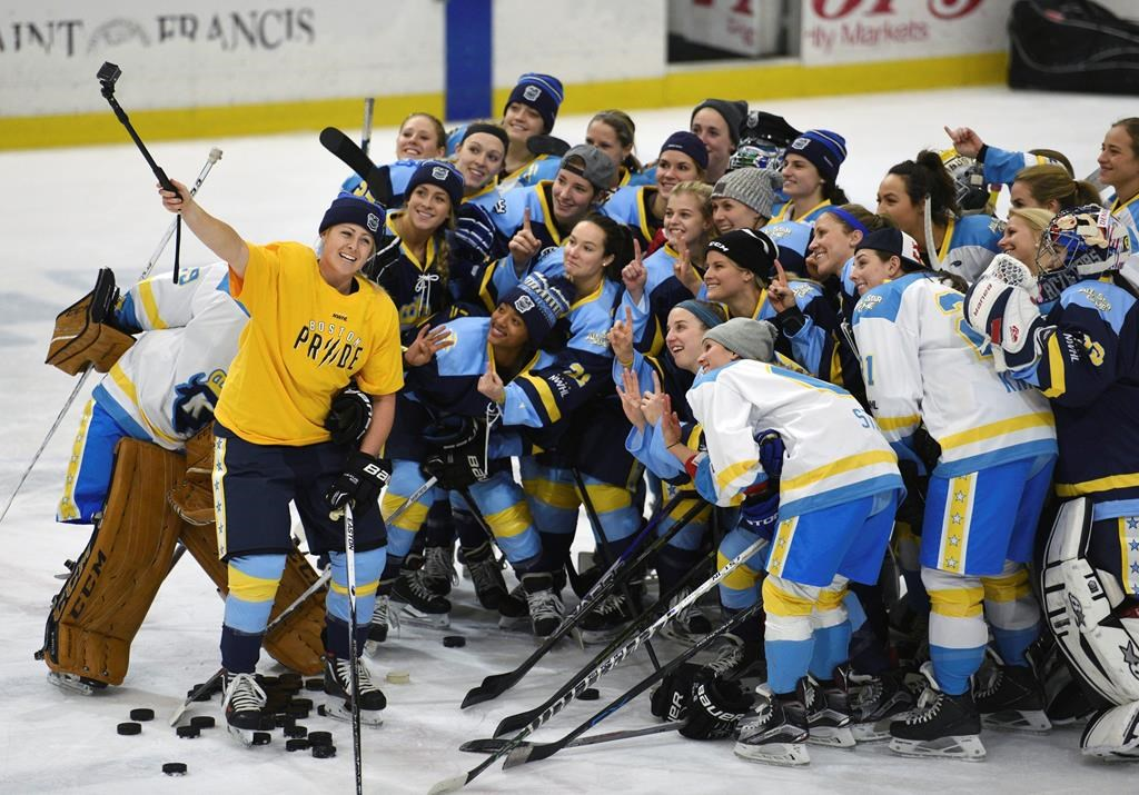 "FILE - In this Jan. 24, 2016, file photo, National Women's Hockey League All-Star players take time for a ""selfie"" before the start of an all-star game at Harborcenter in Buffalo, N.Y."