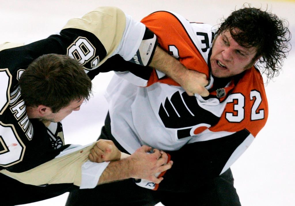 Former NHL enforcer Riley Cote (right) is now heavily involved in cannabis advocacy for athletes.
