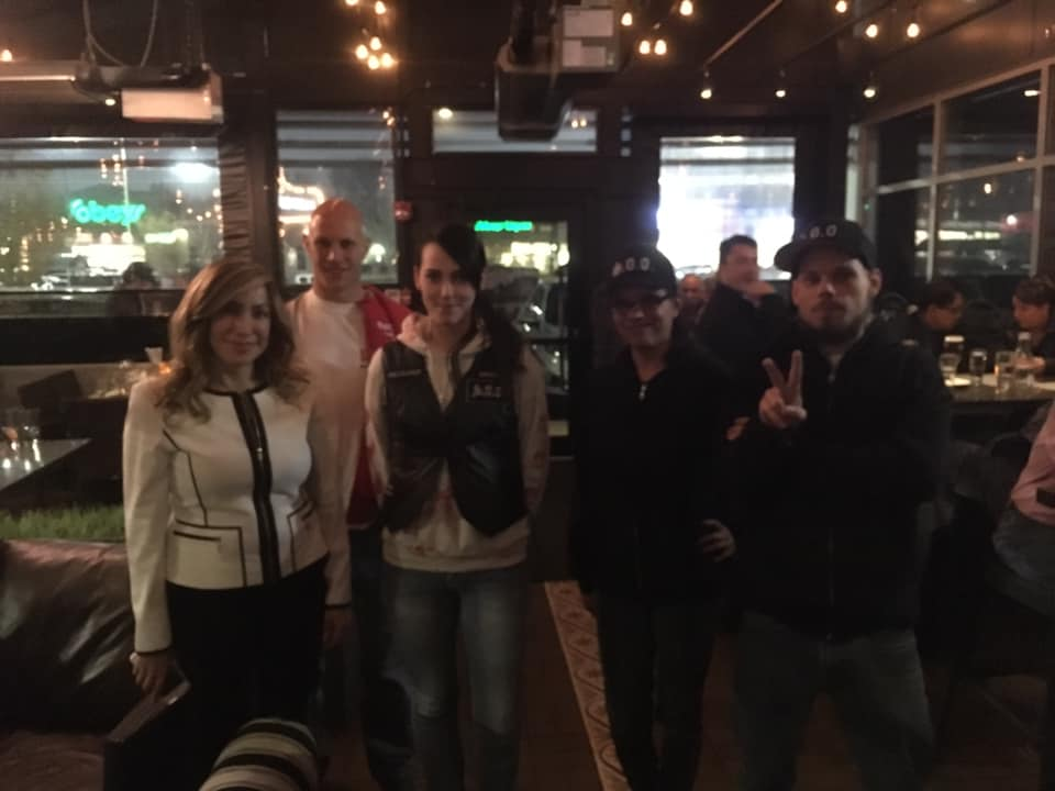 UCP Edmonton-West Henday candidate Leila Houle, left, poses with members of the Soldiers of Odin at a UCP pub night on Friday, Oct. 5, 2018.