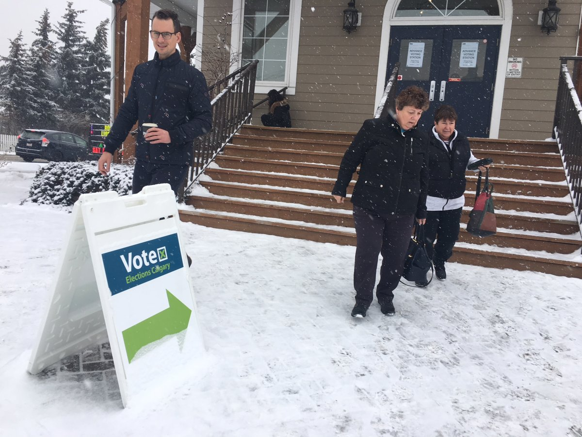 People exit a polling station in Calgary, Alta. for the advance voting for the 2026 Olympic bid plebiscite on Nov. 6, 2018.