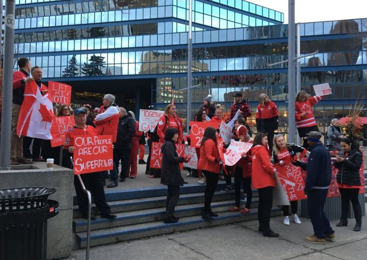 Calgary 2026 Olympic bid supporters rally outside Calgary City Hall on Wednesday, Oct. 31.