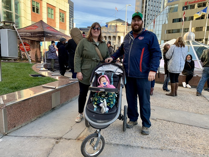 Jenny and Marc Foidart attend Open Fest with their 10-month-old girl at Portage and Main.