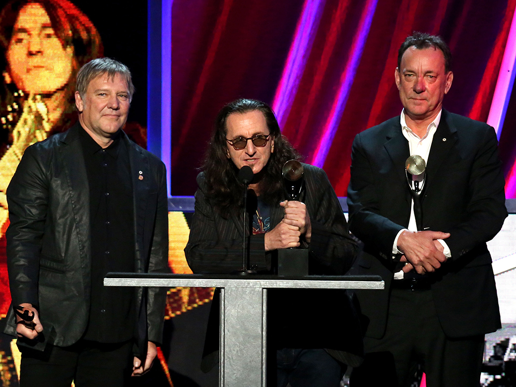 (L-R) Alex Lifeson, Geddy Lee and Neil Peart of Rush onstage during the 28th Annual Rock and Roll Hall of Fame Induction Ceremony at Nokia Theatre, on April 18, 2013 in Los Angeles, Calif.