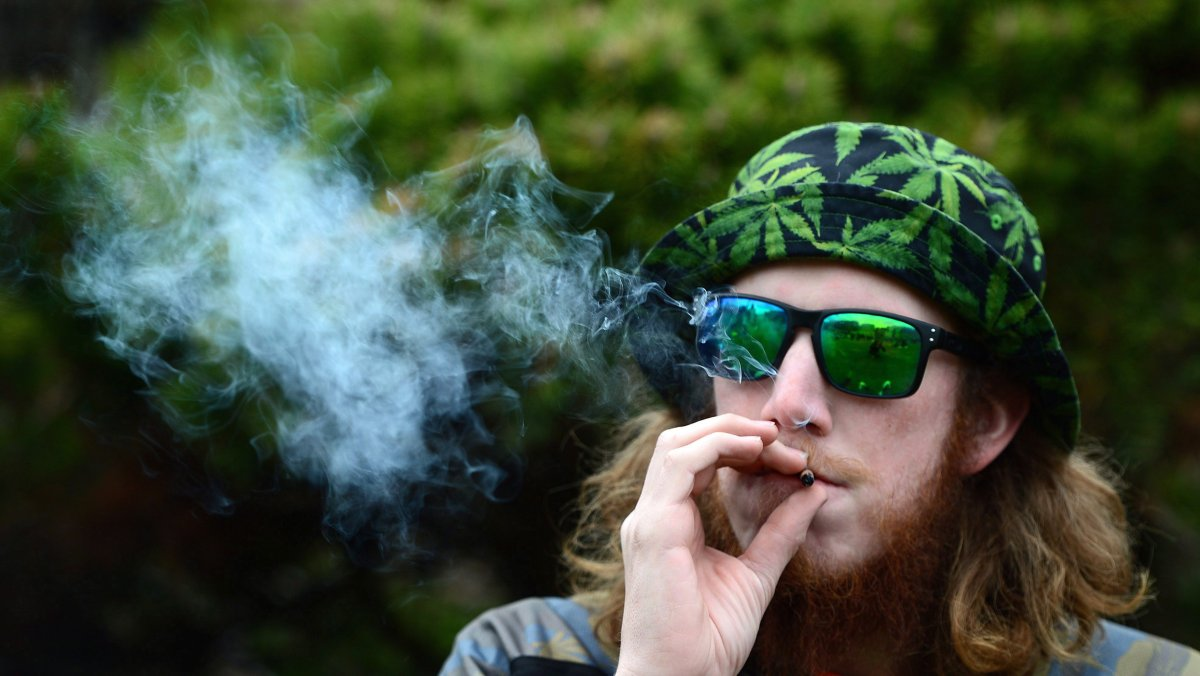 A man smokes during a 4/20 rally on Parliament Hill in Ottawa, on Thursday, April 20, 2017.