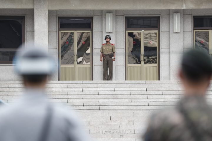In this file photo, a North Korean soldier, centre, and South Korean soldiers face each other at the Joint Security Area in the border village Panmunjom, South Korea.