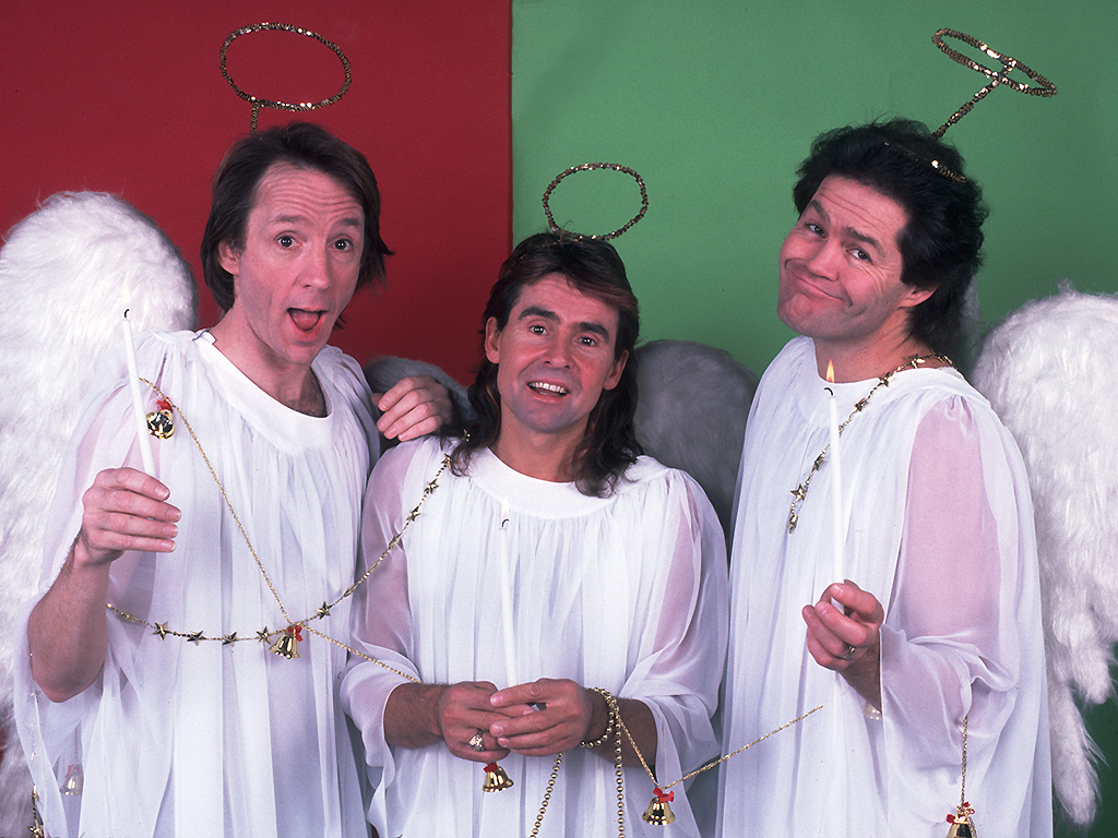 The Monkees pose for their Christmas card at the Athletic & Convocation Center in South Bend, Indiana on November 11, 1986.