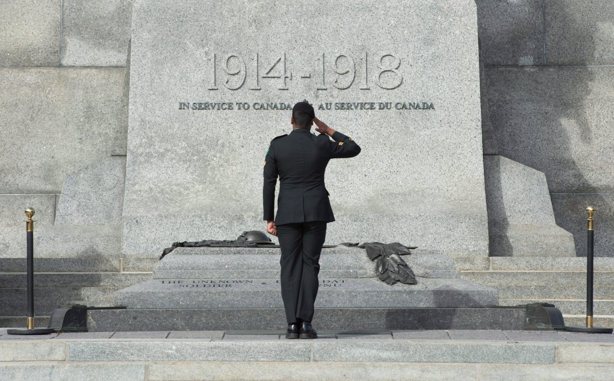 A member of the Canadian Forces salutes as he passes in front of the Tomb of the Unknown Soldier  at the National War Memorial in Ottawa, Wednesday Oct. 22, 2015.