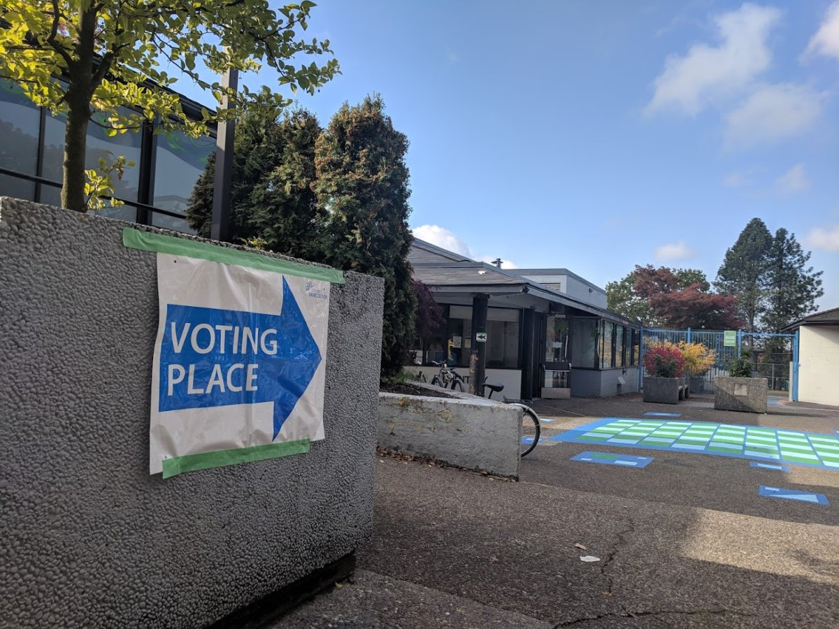 A sign points the way to a voting place in Vancouver.