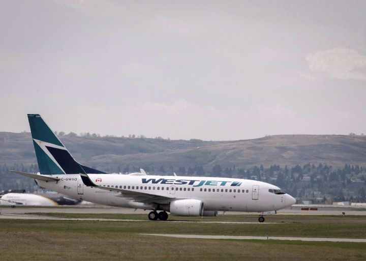 WestJet planes are seen at the Calgary Airport in Calgary, Alta., on Thursday, May 10, 2018.