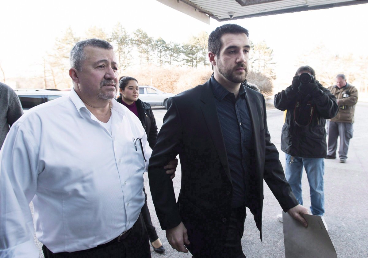 Marco Muzzo, right, arrives with family at the court house for his sentencing hearing in Newmarket, Ont., on February 23, 2016.