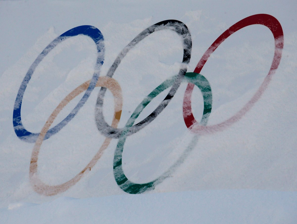 Olympic rings are covered with fresh snow at the Phoenix Snow Park in Pyeongchang, South Korea, Saturday, Feb. 3, 2018.