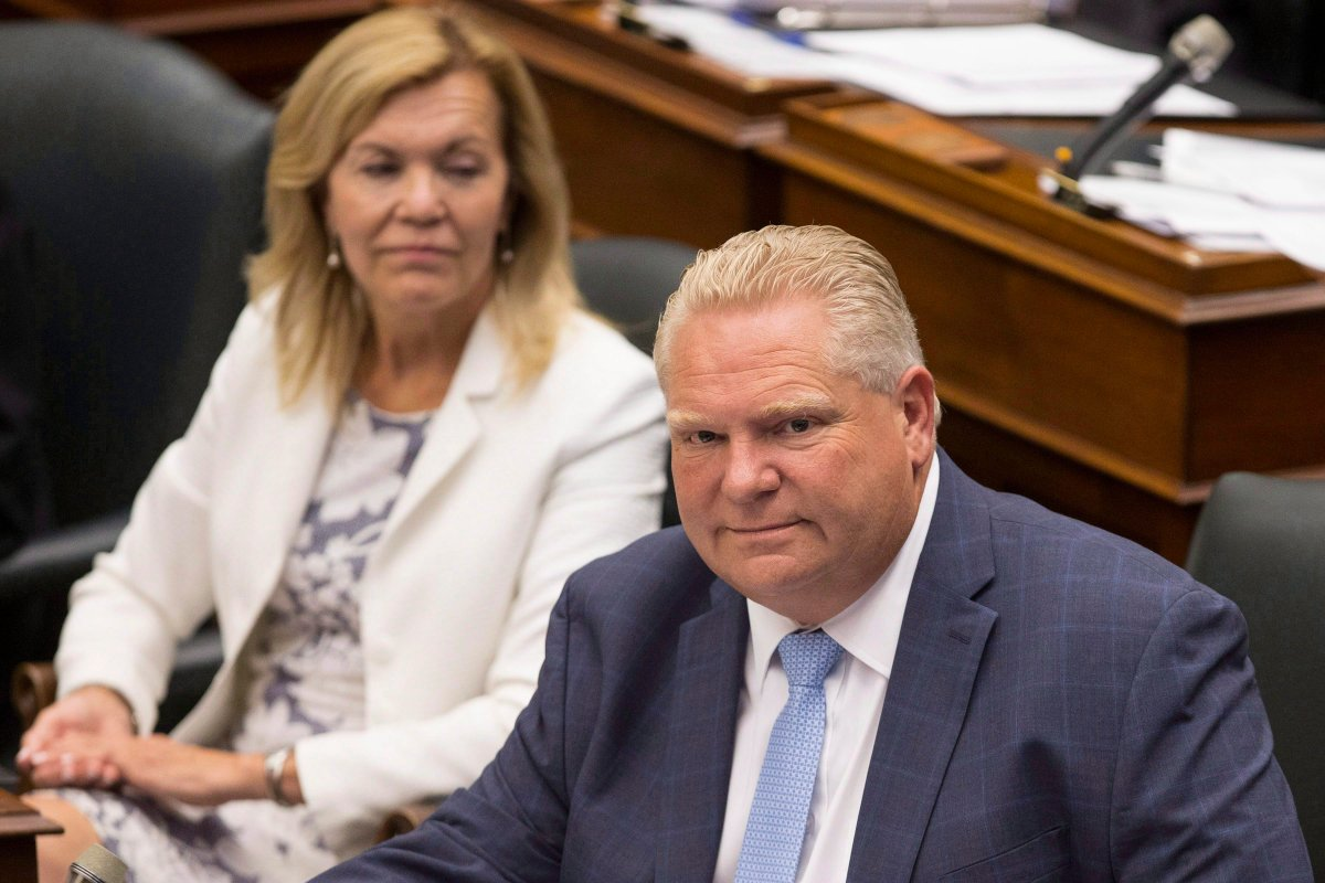 Ontario Premier Doug Ford, right, sits next to PC MPP Christine Elliott during Question Period at Queen's Park, in Toronto on Tuesday, July 31, 2018.