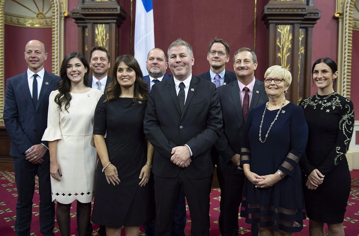 Parti Québécois interim Leader Pascal Bérubé poses with members of his caucus after they were sworn in during a ceremony at the National Assembly Friday, October 19, 2018 at the legislature in Quebec City.