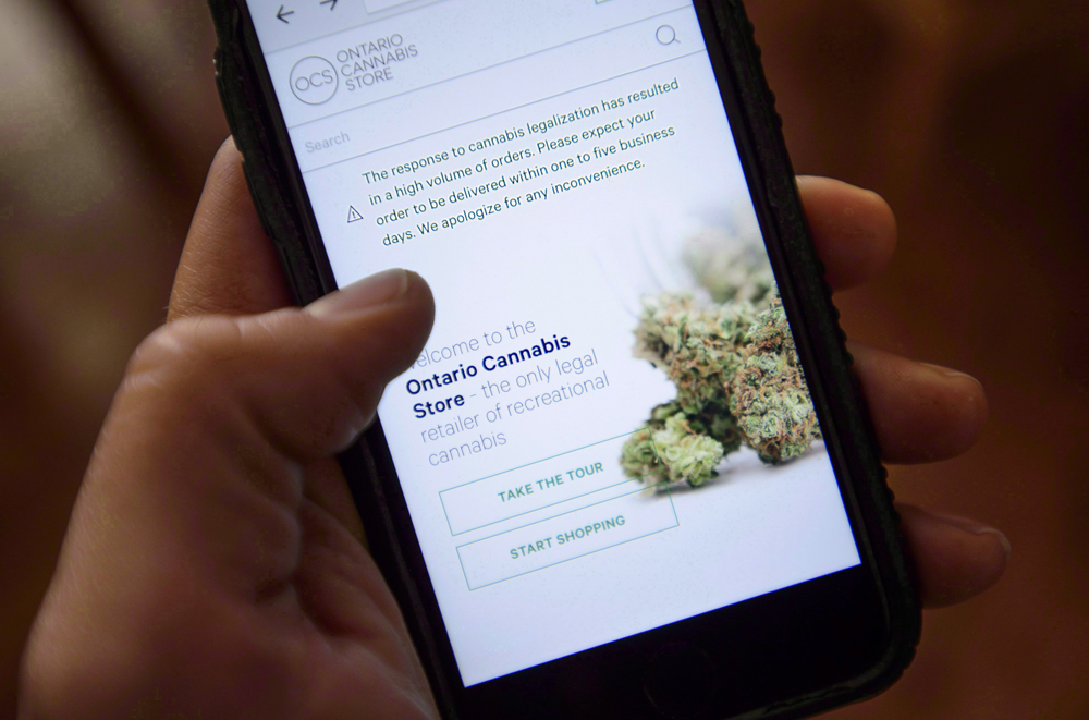 The Ontario Cannabis Store website is pictured on a mobile phone Ottawa on Thursday, Oct. 18, 2018.