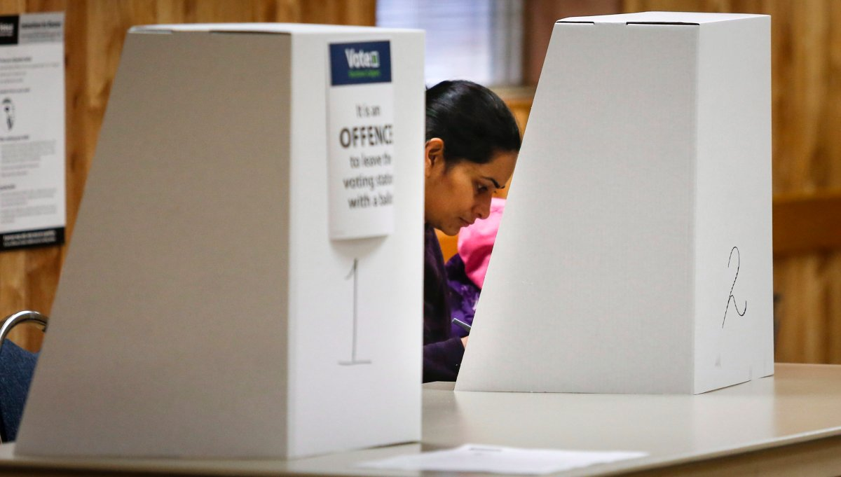 A Calgarian votes in a plebiscite on whether the city should proceed with a bid for the 2026 Winter Olympics, in Calgary, Alta., Tuesday, Nov. 13, 2018.