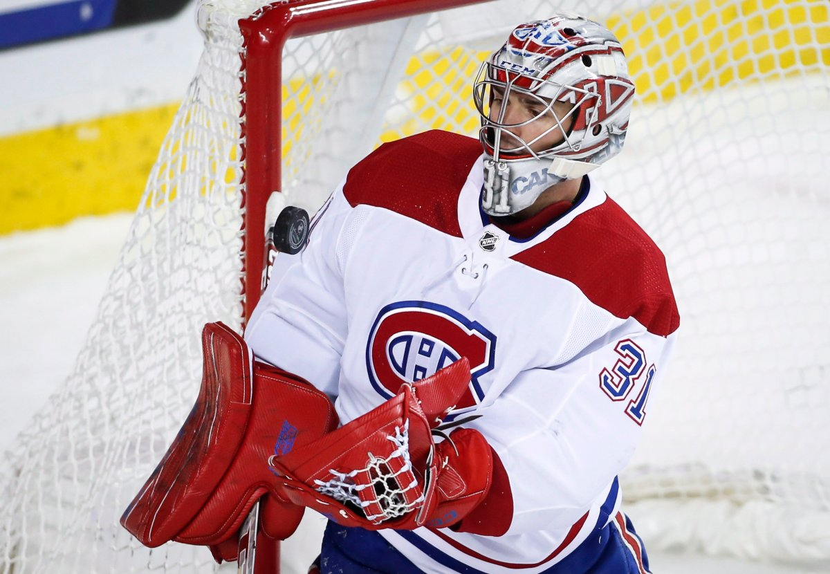 Montreal Canadiens goalie Carey Price grabs the puck during NHL hockey action against the Calgary Flames in Calgary, Thursday, Nov. 15, 2018.