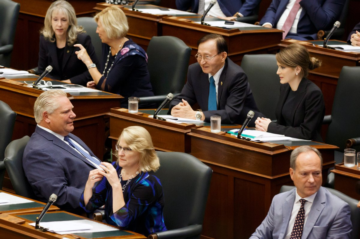 PC MPP Amanda Simard, second row right,  is seen seated amongst fellow MPP's and Ontario Premier Doug Ford, left, as the legislature sits inside Queens Park in Toronto  on Saturday, Sept. 15, 2018.