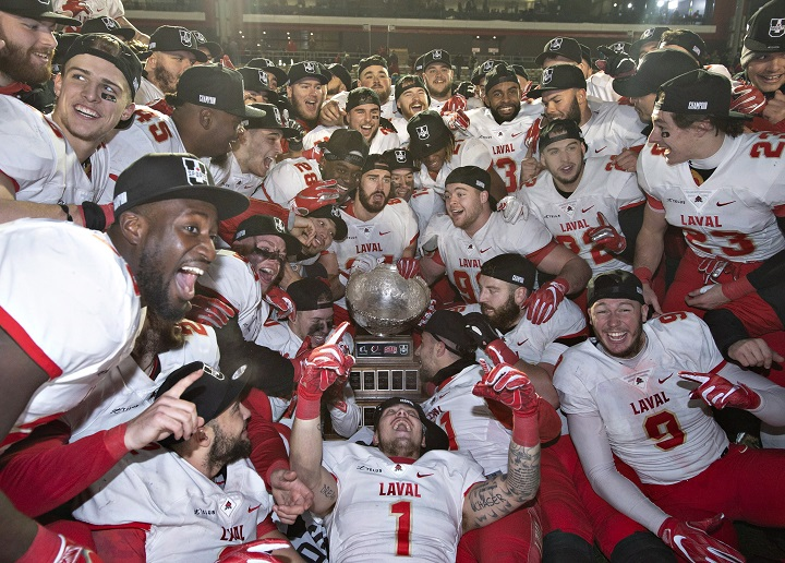 Members of the Laval University Rouge et Or celebrate their victory against Western University Mustangs at the Vanier Cup final Saturday, November 24, 2018 in Quebec City. Laval won 34-20.